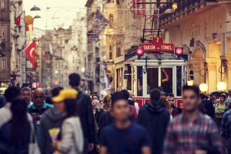 Historic red tram on crowded Istiklal Avenue in Taksim, Istanbul